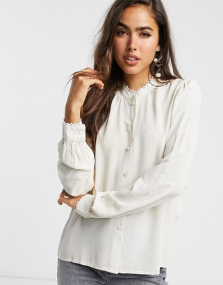 Vero Moda shirt with high neck and pleat detail in cream