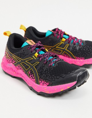 Asics trail FujiTrabuco Lyte in black and pink
