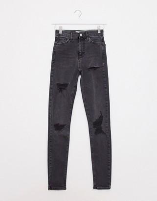 Topshop Jamie skinny jeans with rips in black