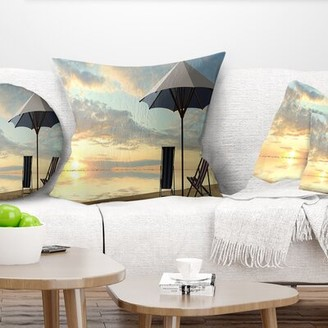 East Urban Home Seascape Deck Chairs and Umbrella on Beach Pillow East Urban Home