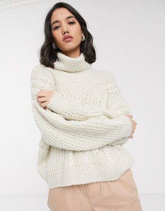 Only chunky cable roll neck jumper in cream