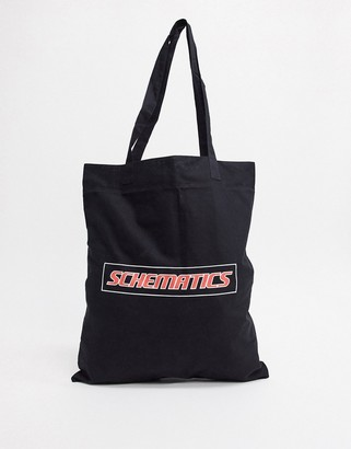Asos DESIGN organic cotton tote bag in black with text print