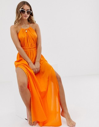 Asos Design DESIGN beach maxi dress with ruched waist & halter neck in orange