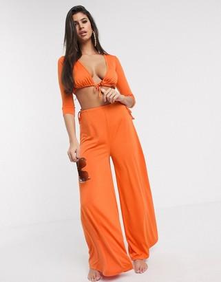 Asos DESIGN jersey orange slinky tie waist wide leg beach pant co-ord in burnt orange