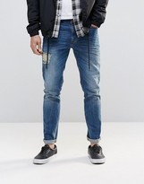 Asos Skinny Jeans With Front And Back Rips In Mid Blue