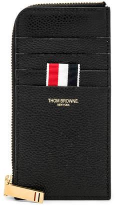 Thom Browne Pebble Grain Half-Zip Wallet in Black | FWRD