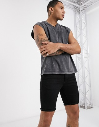 ASOS DESIGN oversized sleeveless t-shirt with notch neck in black acid wash