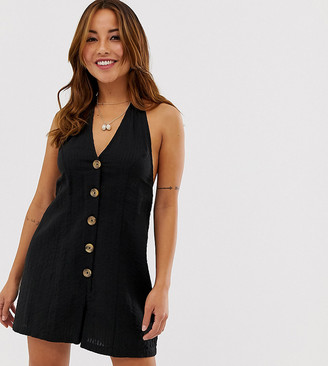 ASOS DESIGN Petite halter romper with button detail in self stripe