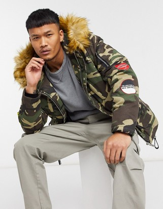 The Couture Club faux fur hooded parka coat with badges in camo print