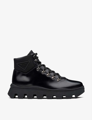 Prada Branded lace-up leather and nylon boots
