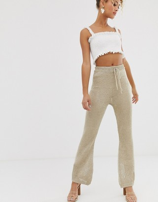 NEVER FULLY DRESSED metallic knitted flare pants two-piece in light gold