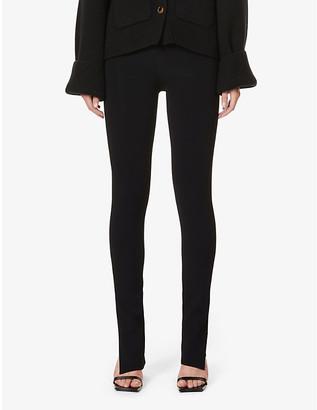 KHAITE Roonie split-cuff skinny high-rise stretch-knit trousers