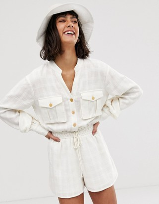 Asos Design DESIGN button front casual textured tie waist utility playsuit with pocket detail-White