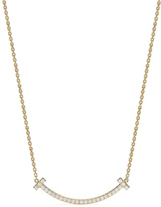 Tiffany & Co. T medium smile pendant in 18k gold with diamonds