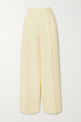 REMAIN Birger Christensen Camino Cotton And Linen-blend Tapered Pants - Pastel yellow