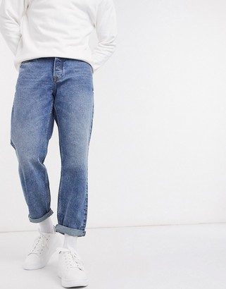 Topman loose fit jeans in mid wash blue