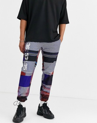 Asos Design DESIGN tapered trousers in all over text print-Blue