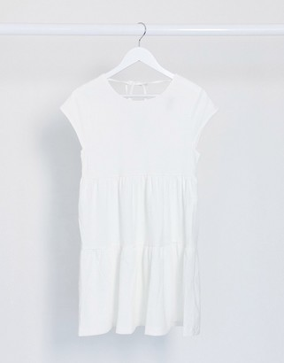 Bershka mini tiered smock dress in ecru