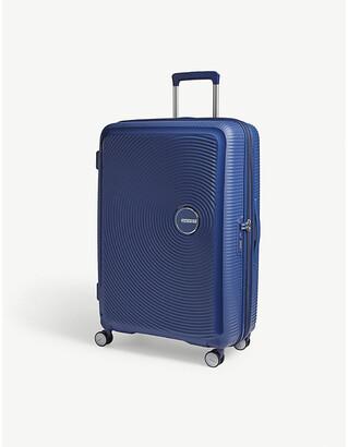 American Tourister Soundbox expandable four-wheel suitcase 77cm
