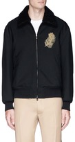 Alexander McQueen Peacock feather embroidered down coach jacket