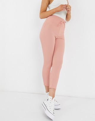 In The Style x Demi Jones skinny jogger in soft coral