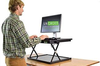 CHANGEdesk Mini Affordable Adjustable Height Laptop/Desktop Standing Desk Conversion. Compact ergonomic sit to stand desktop computer riser converter