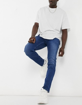 Replay Anbass slim fit jeans in medium blue