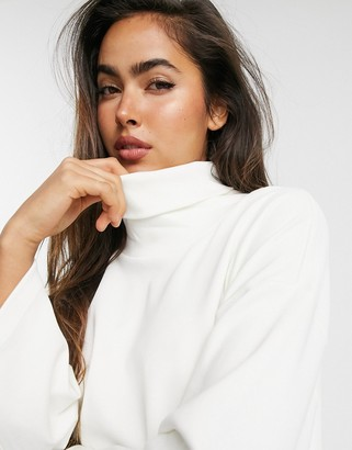 ASOS DESIGN structured oversized top with high neck in cream