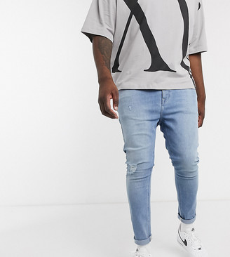ASOS DESIGN Plus spray on jeans with power stretch in light wash with abrasions