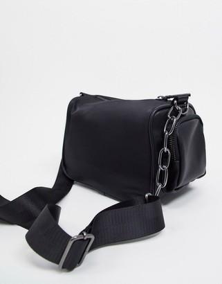ASOS DESIGN 90's cross body barrel bag in black faux leather