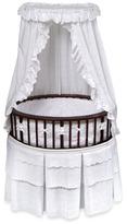 Badger Basket Oval Bassinet in Cherry with White Eyelet Bedding