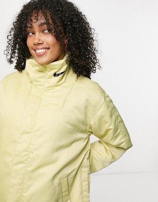 Nike premium jacket in gold with logo print collar
