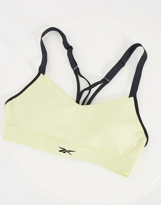 Reebok Training strappy padded bra in lemon