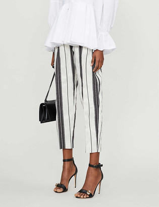 Alexander McQueen Striped tapered high-rise cotton and linen-blend trousers
