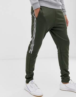 Hollister leg logo side piping cuffed sweatpants in olive-Gray
