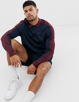 Asos Design DESIGN organic long sleeve polo shirt with contrast shoulder panel in navy