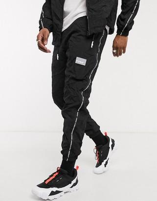 Puma Evide tape sweatpants in black
