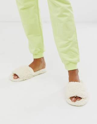 Truffle Collection fluffy slippers in cream-Multi