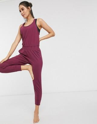 Nike Training Nike Yoga jumpsuit in burgundy