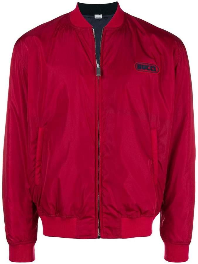Gucci reversible logo bomber jacket