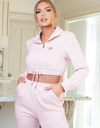 The O Dolls Collection high neck zip detail crop hoody with logo in pink