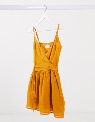ASOS DESIGN tie wrap around crinkle mini sundress in mustard