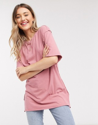ASOS DESIGN super oversized t-shirt with exposed seams in washed rose