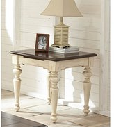 Tone Walnut And Antique Distressed White Wood End Table With Turned Legs Design And A Handy Pull Out Tray That Adds Additional Surface Area When Needed.