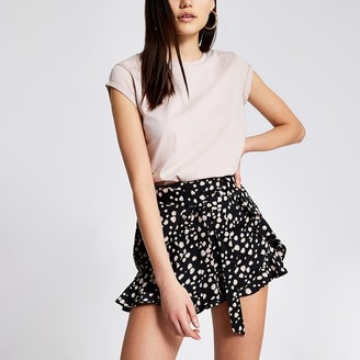 River Island Black printed tie belted frill shorts