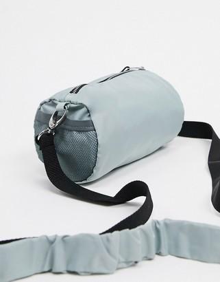 ASOS DESIGN 90's mini cross body barrel bag in light grey