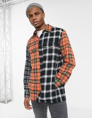 Religion spliced check shirt in black and orange