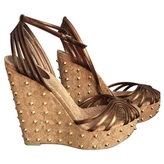 Gucci Gold stud leather wedges