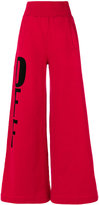Off-White flared trousers - women - Cotton - XS