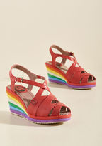 Marlene A search for footwear that rewards the soul with whimsy ends with these rainbow wedges from London-based brand Miss L Fire! The overlapping uppers of these quirky-cool peep toes embody Hollywood's golden era of glamour, while their layered heels in